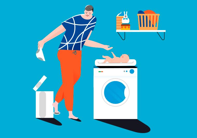 Isä vaihtaa vauvan vaippaa pesukoneen päällä.